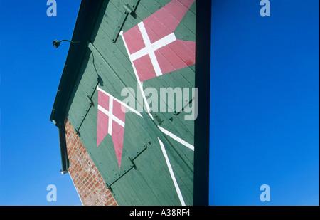 DANISH FLAGS ON GREEN DOOR - Stock Photo