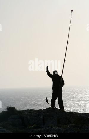 successful fisherman at Sagres Algarve Portugal - Stock Photo
