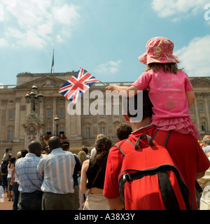 Girl waves Union Flag outside Buckingham Palace on Queens 80 Birthday her majesty highness on balcony L - Stock Photo