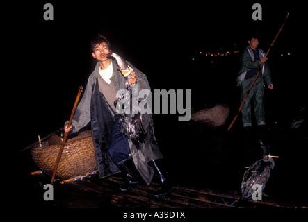 Chinese people person adults males men fishermen fishing with cormorants along Li River Guilin Guangxi Province - Stock Photo