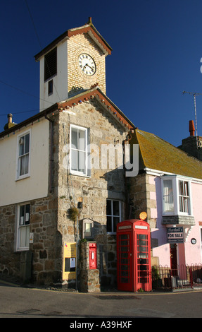 UK, South Cornwall, Mousehole, Post Office with posting box and telephone box, Mousehole Harbour, early morning - Stock Photo