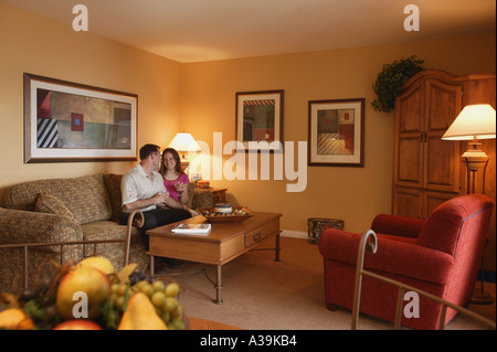 Couple relaxing in room - Stock Photo
