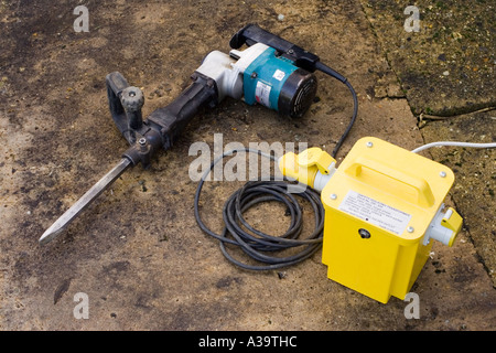 hammer drill breaker and transformer - Stock Photo