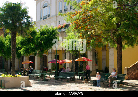 Square in the centre of Silves town in the Algarve region of southern Portugal with cafes and trees - Stock Photo