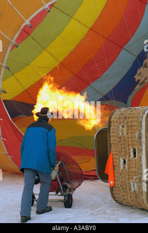 Inflating a hot air balloon at the Chateau d'Oex balloon festival, Switzerland