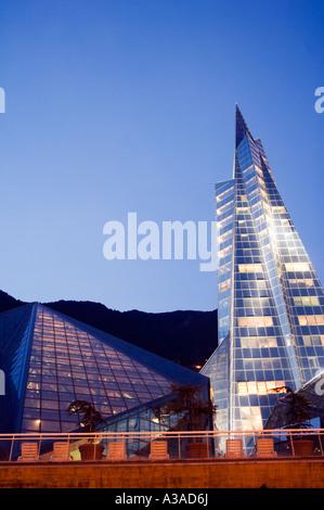 Andorra Andorra La Vella Hot Spring Complex Caldea lit up in the evening - Stock Photo