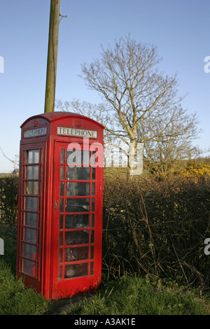 old red telephone box GPO British Telecom by lane blue sky county down northern ireland - Stock Photo