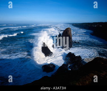 Huge Pacific Ocean breakers crash against offshore rock at Seal Rock State Park near Newport on the Central Oregon - Stock Photo