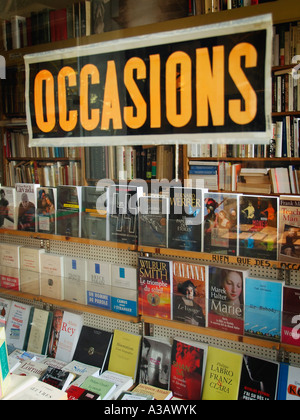 Used pre owned secondhand books in a special bookshop with large occasions sign on the window Brussels Belgium - Stock Photo