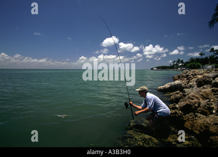 A MAN CATCHES A FISH CAPTIVA ISLAND FLORIDA - Stock Photo