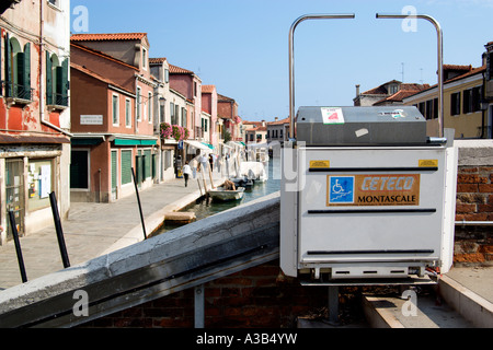 ITALY Veneto Venice Electric wheelchair lift or ramp on bridge across Rio dei Vetrai canal on Lagoon island of Murano. - Stock Photo