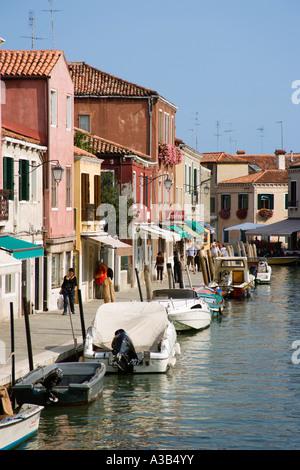 ITALY Veneto Venice Lagoon Murano Island Tourists walk on  Fondamente dei Vetrai beside shops and canal with boats - Stock Photo