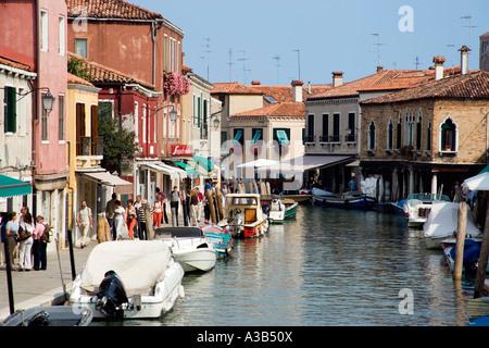 ITALY Veneto Venice Tourists walking beside main canal on Fondamente dei Vetrai on glass making Lagoon Island of - Stock Photo