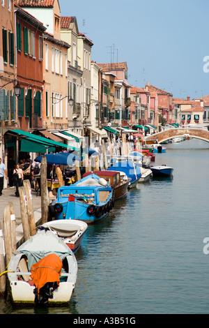 ITALY Veneto Venice Tourists walking by main canal on Fondamente dei Vetrai on glass making Lagoon Island of Murano - Stock Photo