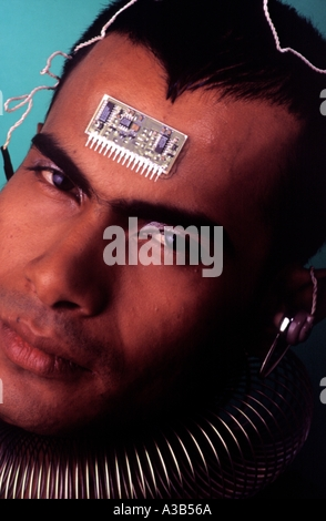 Portrait of a man with a computer chip in his forehead - Stock Photo