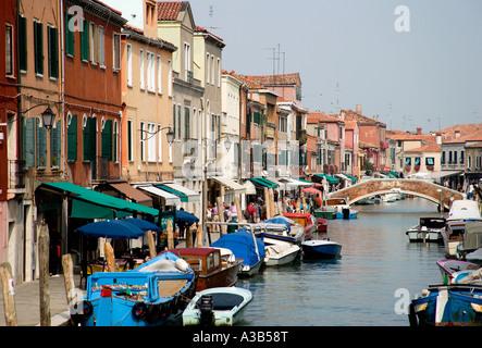 ITALY Veneto Venice Murano Lagoon Island The main canal of Fondamente dei Vetrai with boats moored on quay and bridge - Stock Photo