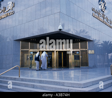 KUWAIT Middle East Gulf State Kuwait City Exterior of Al Ahli Bank of Kuwait with two men about to enter - Stock Photo