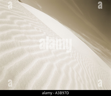 Wind swept symmetrical sand dune at White Sands National Monument New Mexico - Stock Photo