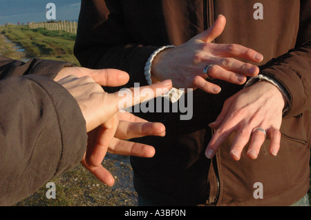 close up of the hands of two men having a conversation in british sign language - Stock Photo