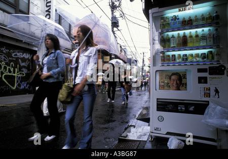 Japanese girls walking in the streets of Harajuku Tokyo Japan - Stock Photo