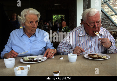 A German couple eating lunch at motorway services near Dusseldorf, North Rhine-Westphalia, Germany. - Stock Photo