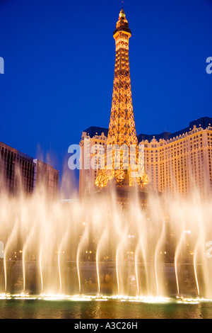 Bellagio fountains perform in front of the Eiffel Tower replica of the Paris Casino on the Las Vegas Nevada USA - Stock Photo
