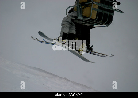 Skiers on a ski lift.  Skiing in the Canadian Rockies - Stock Photo