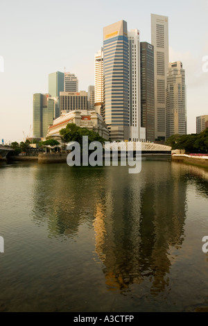 Cavenagh Bridge and the Singapore Central Business District - Stock Photo