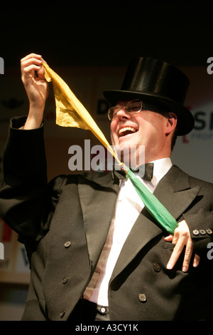 Performance of Peer Steinbrueck which is manipulated by a magician behind his back - Stock Photo