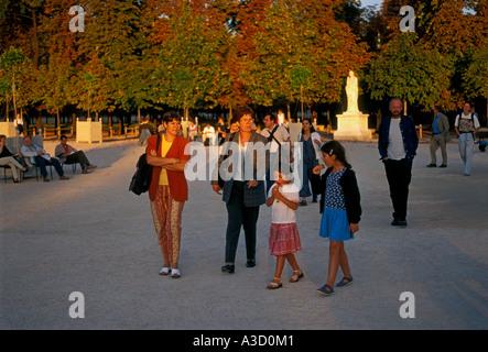 French people adult women and children little girls mothers walking children, Tuileries Garden, Jardin de Tuileries, - Stock Photo