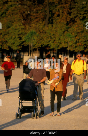 French people, mother and father, baby, infant, child, children, family, tourists, Tuileries Garden, Paris, Ile - Stock Photo
