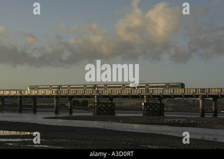 A Southern Electrostar commuter service passing over the River Adur, Shoreham-by-Sea, West Sussex, Engalnd, UK. - Stock Photo