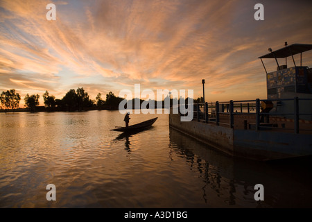 The ferry leaving Korioume the port of Timbuktu to cross the Niger river in the dawn Mali West Africa - Stock Photo