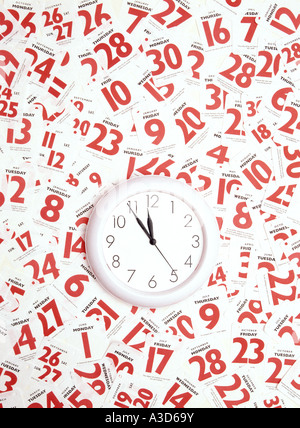 Daily tear off calendar pages around clock face busy appointments schedules conceptual image - Stock Photo