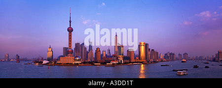 Shanghai Skyline viewed over the Huangpu River China - Stock Photo