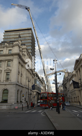 Lorry mounted telescopic crane at work in Pall Mall London - Stock Photo