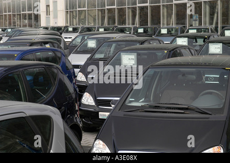 Mercedes car sale in front of the office building of Mercedes Benz, Berlin, Germany - Stock Photo