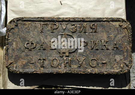 Tea brick with hammer and sickle and cyrillic script at the market Ulaangom Mongolei - Stock Photo