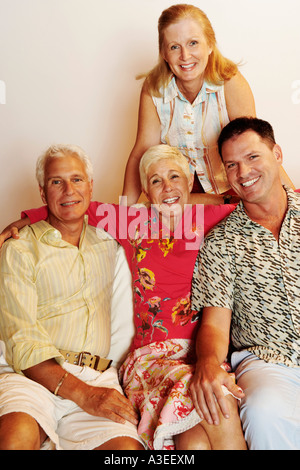Portrait of a mature couple posing with a mature man and a senior woman - Stock Photo