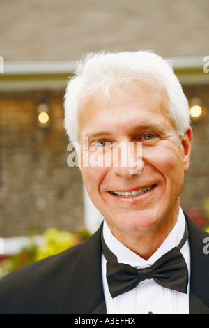 Portrait of a mature man smiling - Stock Photo