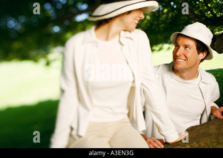 Close-up of a mid adult couple looking at each other and smiling - Stock Photo