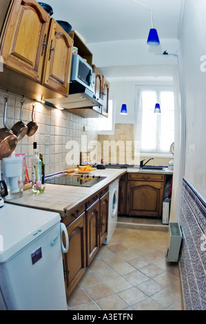 Paris France, After Renovations, Apartment Kitchen Italian 'Ceramic Tile' Countertop Oak Cabinets (see before image - Stock Photo