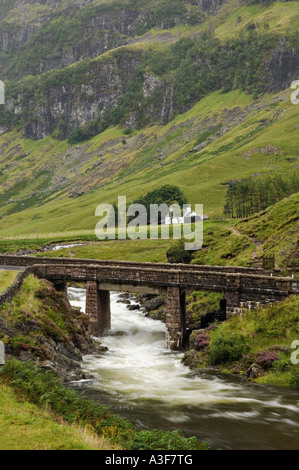 Stone Bridge Crossing the River Coe with Croft in the Background Glen Coe Scotland - Stock Photo