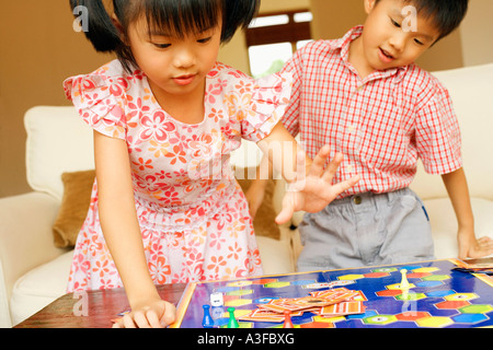 Close-up of a boy playing with his sister Stock Photo