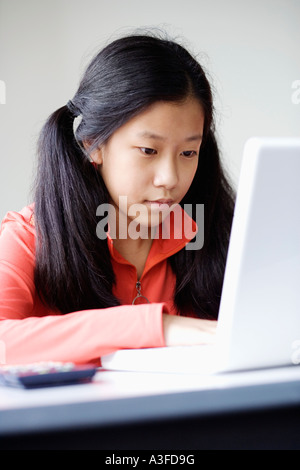 Close-up of a girl using a laptop - Stock Photo