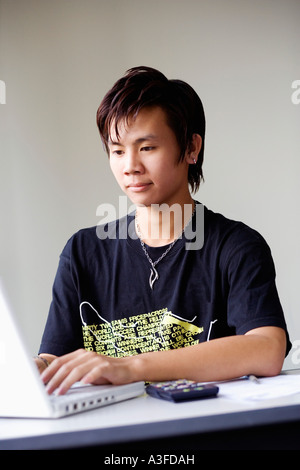 Close-up of a boy using a laptop - Stock Photo
