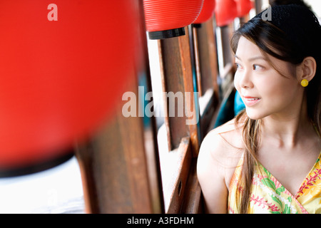 Close-up of a young woman looking out the window of a tourboat - Stock Photo