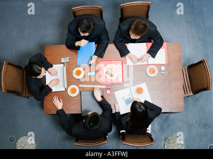 High angle view of five business executives in a meeting - Stock Photo