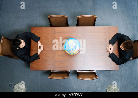 High angle view of two businessmen sitting at a conference table - Stock Photo