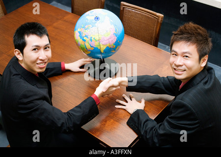 Portrait of two businessmen shaking hands - Stock Photo